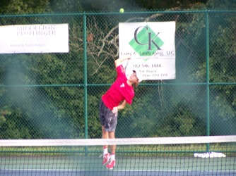 Senior Jerid Inman serves angist Floydś two singles player