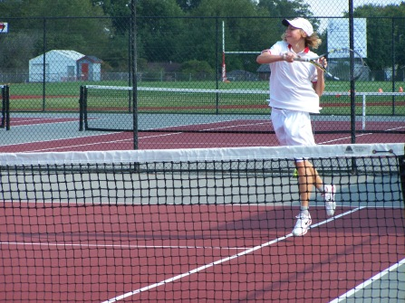 Keith Asplund hits cross courts to teammate and fellow senior Jerid Inman