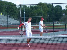 Junior Blake Winchell hits a volley before the jeffersonville Invite begins