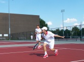 Senior Trey Bottorff hits a low backhand slice preparing for the jeffersonville invite