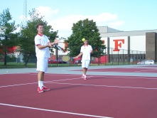 Jeffersonville one and two doubles team warm up together before the Jeffersonville invite