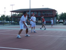 Sophomore Tien-Lu Huang vollies at the net at warm ups friday afternoon prepares for the Jeffersonville Invite