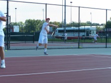 Freshman Bryce Vernon hits a forehand in warm ups Friday afternoon before the Jeffersonville invite