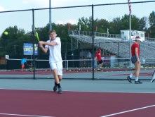 Junior Kyle Lemon hits a backhand return to Senior Luke Astle