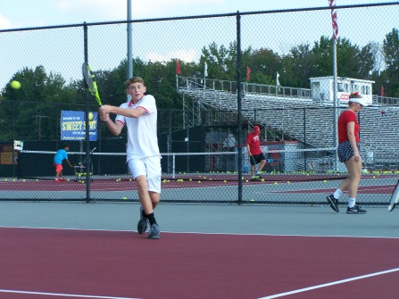 Junior Kyle Lemon hits a backhand return to Senior Luke Astle