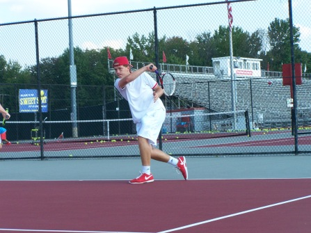 Sophomore Gavin Lone hits a forehand to Junior Jared wells during warm ups alongside his partner Kyle Lemon