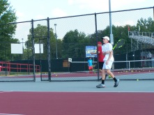 Junior Kyle Lemon hits a forehand slice drop shot to Senior Luke Astle in warm ups Friday afternoon