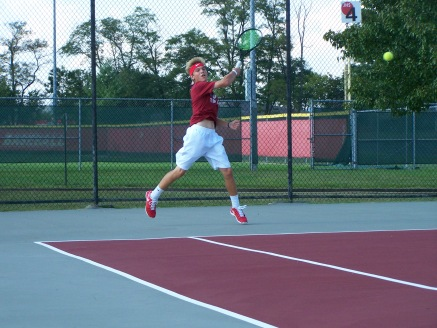 Sophomore Jared Wells hits a forehand return before the Jeffersonville invite began