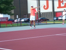 Senior Luke Astle hits a forehand alongside Sophomore Jared Wells during warm ups before the Jeffersonville invite