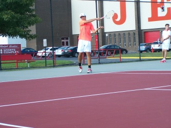 Senior Luke Astle hits a forehand alongside Sophomore Jared Wells during warm ups before the Jeffersonville invite