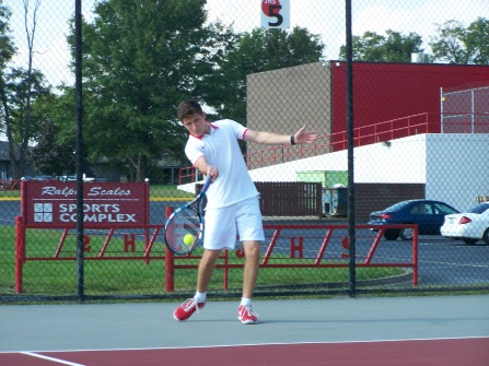 Sophomore Evan Thompson hits a forehand