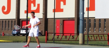 Junior Tommy Gregory hits a forehand at the Jeffersonville High School Friday afternoon