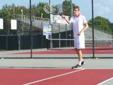 Senior Zach Giuffre hits a forehand in warm ups before Jeffersonville invite Friday afternoon