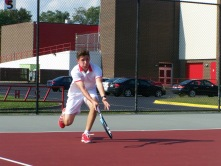 Sophomore Evan Thompson runs up to hit a short forehand before the Jeffersonville Invite
