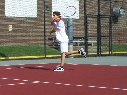 Junior Juan hits a forehand to Sophomore Evan in warms up Friday afternoon before the Jeffersonville Invite