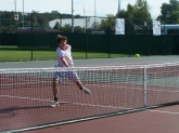 Sophomore Joey Zelli hits a volley with Freshman Grant Paradowski Friday afternoon before Jeffersonville Invite began