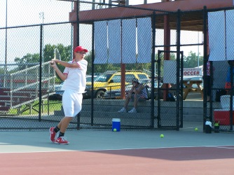 Freshman Charley Williams hits a backhand in a rally Friday night