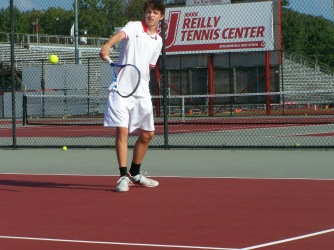 Sophomore Joey Zelli hits a backhand slice to fellow Sophomore Ben Harbeson in warm ups Friday afternoon