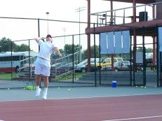 Senior Jake Lemon warms up his serve for Friday nights match