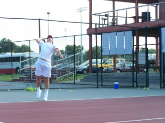 Senior Jake Lemon warms up his serve for Friday nights match