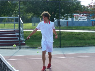 Senior Gerrin Moore hits a forehand volley Friday afternoon before the Jeffersonville Invite