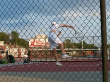 One singles Keith Asplund serves the first point against New Albany Friday night