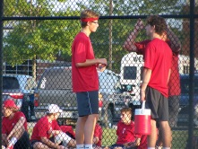 Coach Nathan Cross talks to Senior Trey Bottorff and Junior Colby Kayrouz