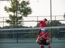 Junior Colby Kayrouz serves the first point in a new game as his partner Senior Trey Bottorff takes ready position to cover the net