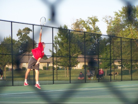 Junior Colby Kayrouz serves to break 30 all in the one doubles match against Castle