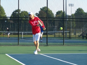 Keith Asplund one singles hitting a forehand in warms up at the Jasper tournament