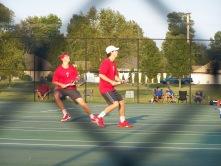 one doubles team tracks a overhead.
