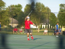 Senior Trey Bottorff lunges to put away a forehand volley