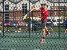 Sophomore Adam Crawford serves in first round of Jasper tournament.
