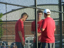 two doubles team talks with Coach Cross