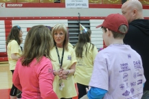 Dr. Mariane Fisher speaks with students at the Dance Marathon event.