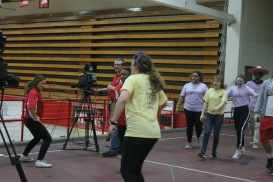 Ellie Melin dances over to some of the WJHI student journalists.
