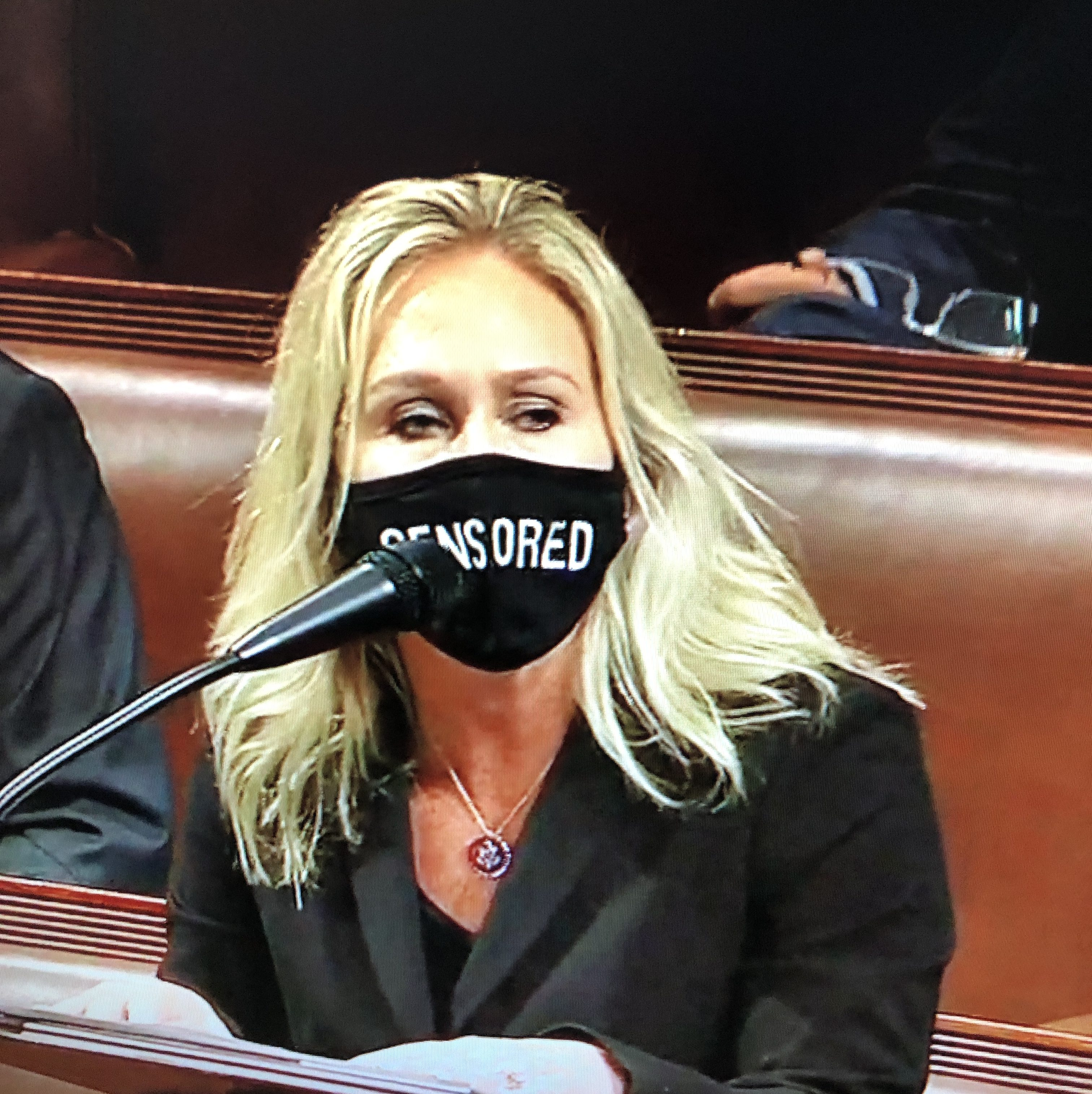 "After social media accounts were restricted in the wake of the U.S. Capitol insurrection on January 6, Republican Congresswoman Marjorie Taylor Greene of Georgia wore a ""Censored"" mask while speaking on the floor of the House of Representatives. Hyphen Staff Photo"
